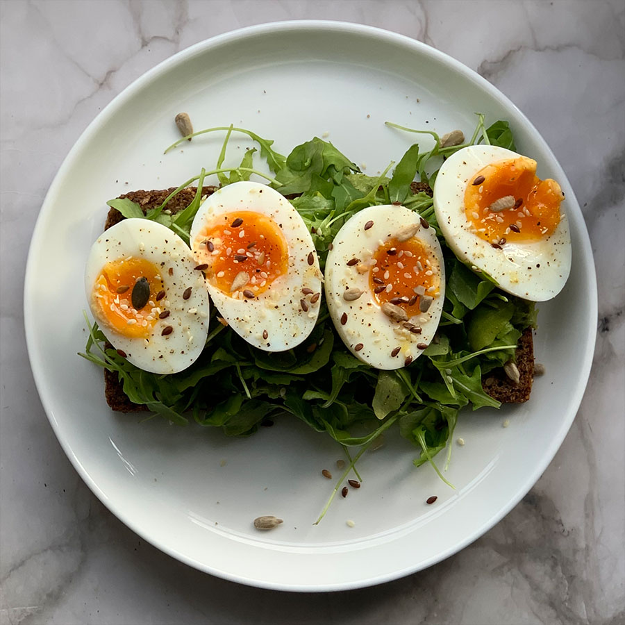 A healthy breakfast recipe of eggs, rocket and avocado toast by nutritionist Jennifer Medhurst